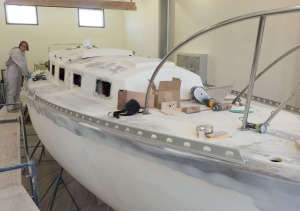 The starboard side is also fitted. Now we will decide where the life line stanchions will go and then remove the toe rail so we can cast all of the holes with epoxy.