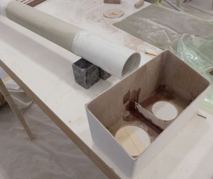 "you can see the baffel epoxied in place. The 4"" PVC pipe has been covered in fiberglass and is ready to become the air tubes."