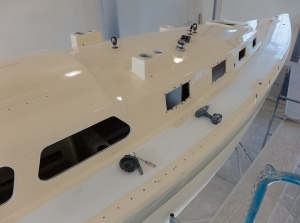 Sunday we put on the Main sail reefing winch,  turning blocks and line clutches.  We also put the deck plates on the dorade vents and a block for the main sheet.