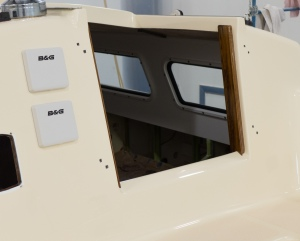 You can see the non skid on the seats and the teak trim on the sides of the companion way hatch opening.